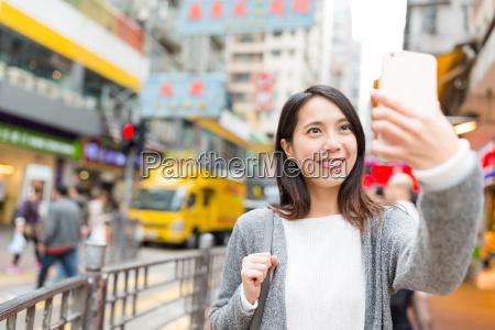woman, taking, selfie, in, mong, kok - 22648193