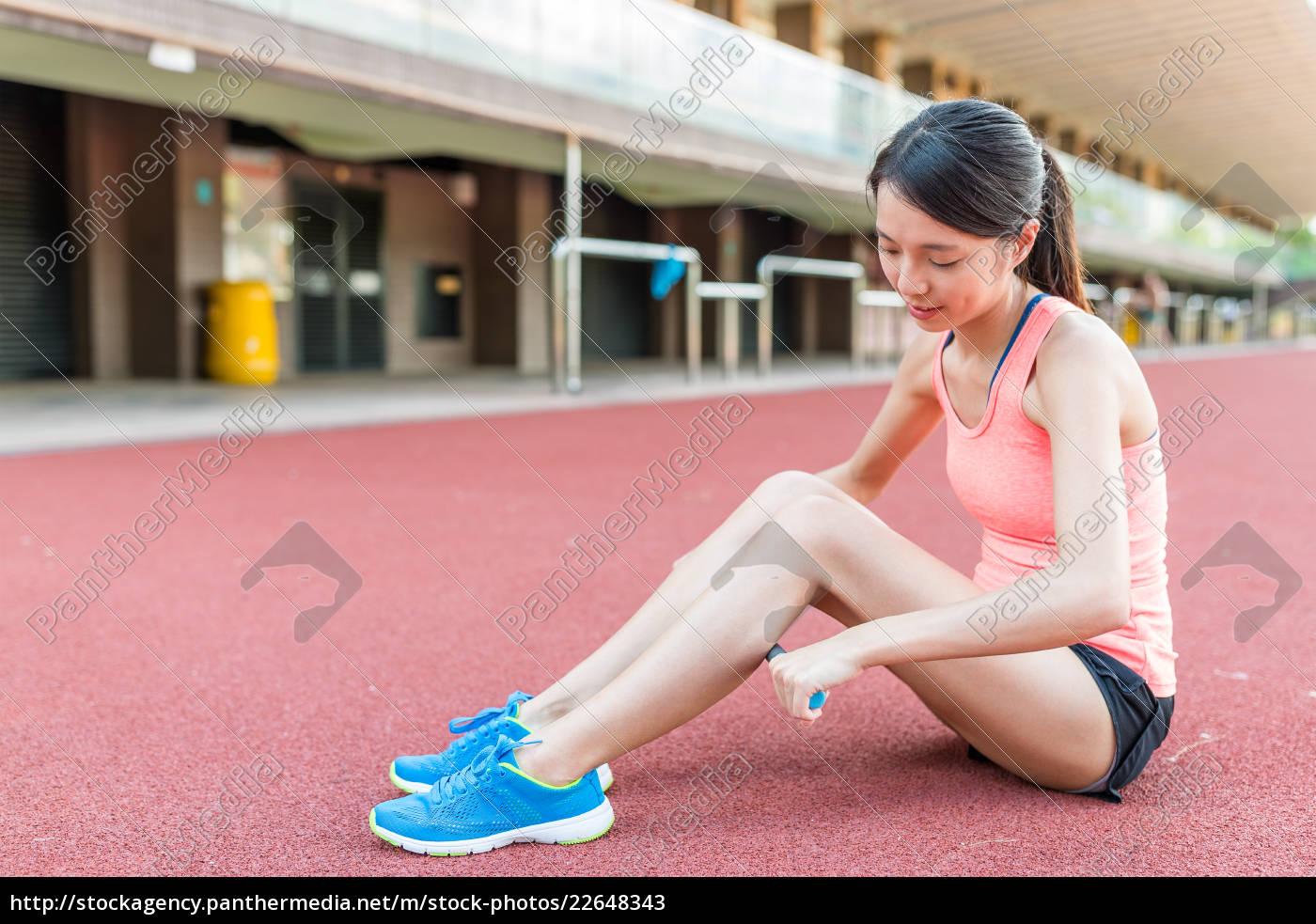 woman, using, stick, massage, roller, on - 22648343
