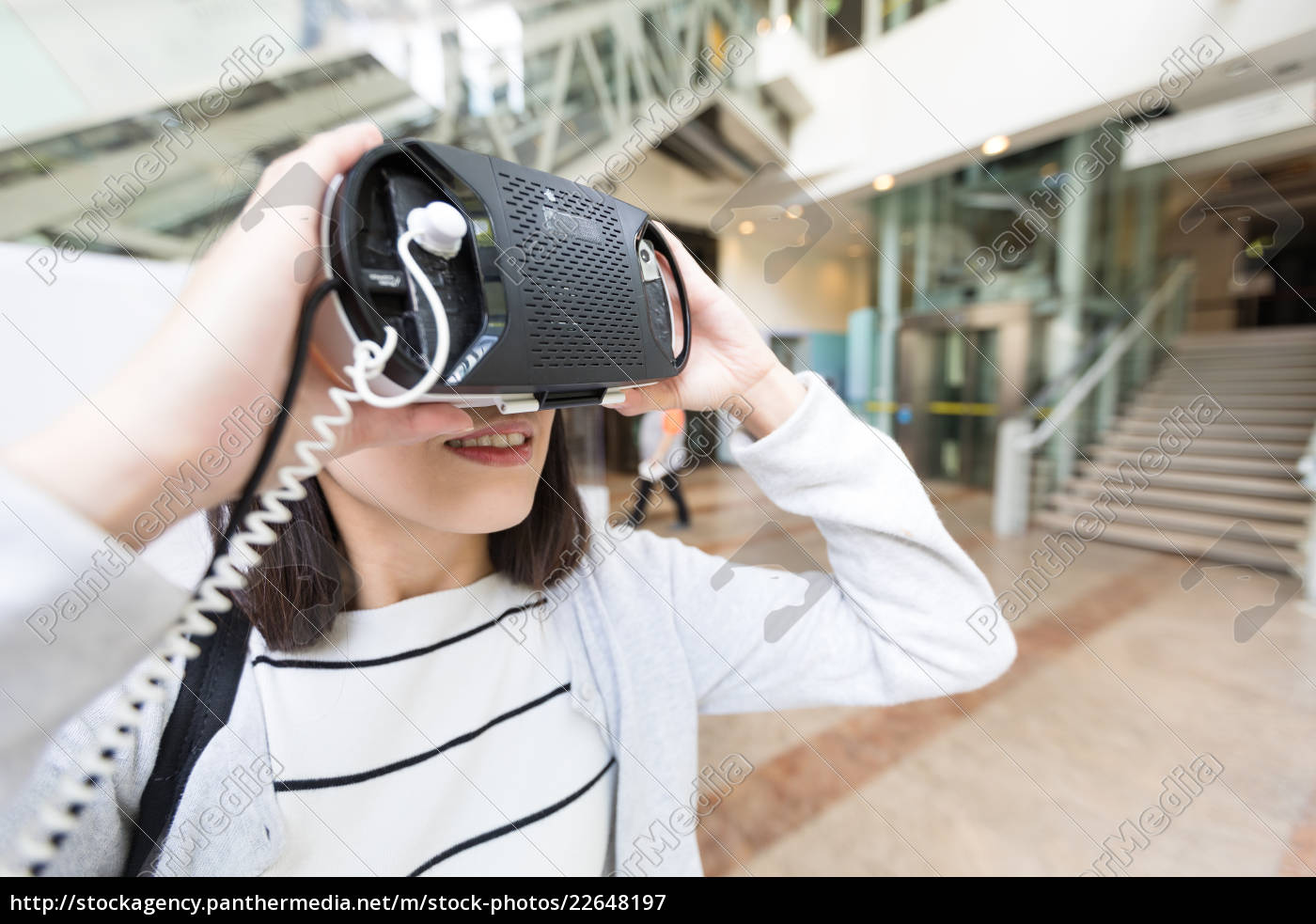 woman, watching, with, virtual, reality, device - 22648197