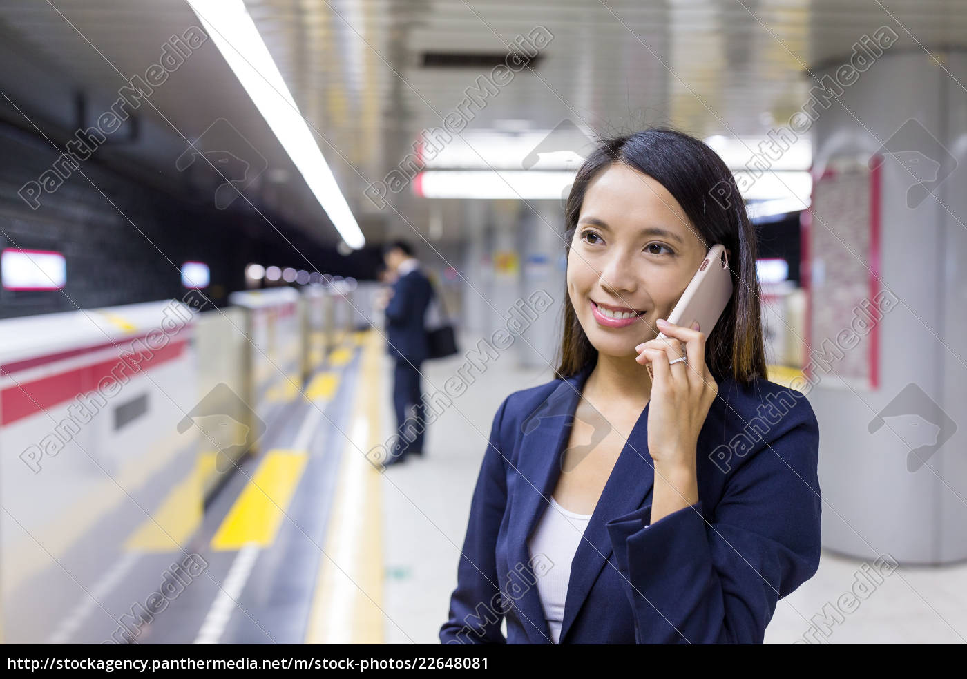 young, businesswoman, talk, to, cellphone, in - 22648081