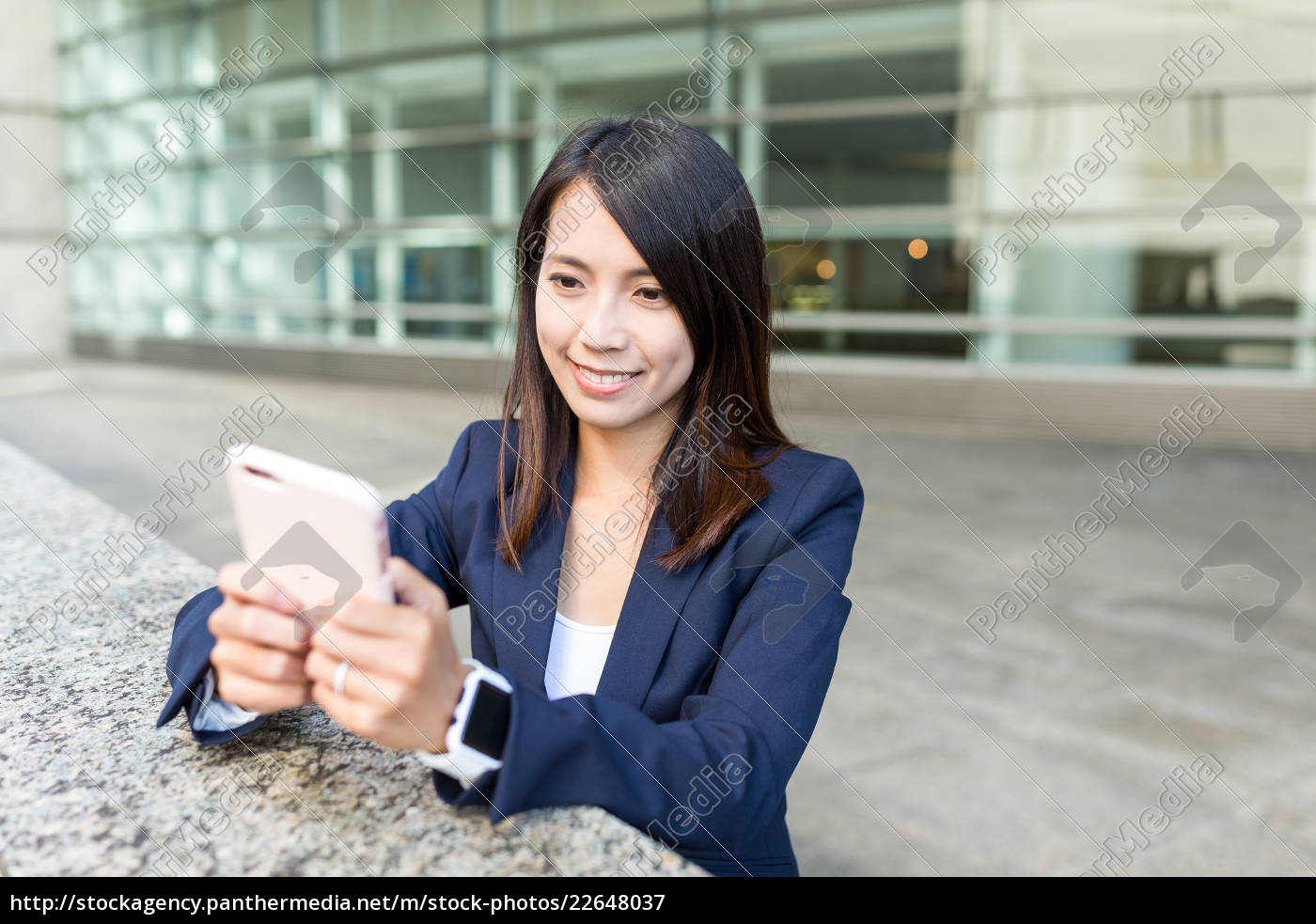 young, businesswoman, working, on, cellphone - 22648037