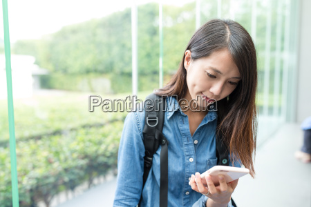 young, woman, looking, at, the, cellphone - 22648033