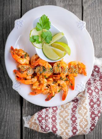 fried prawns with lemon served on