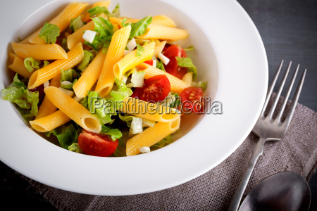 pasta salad with fresh greenery and