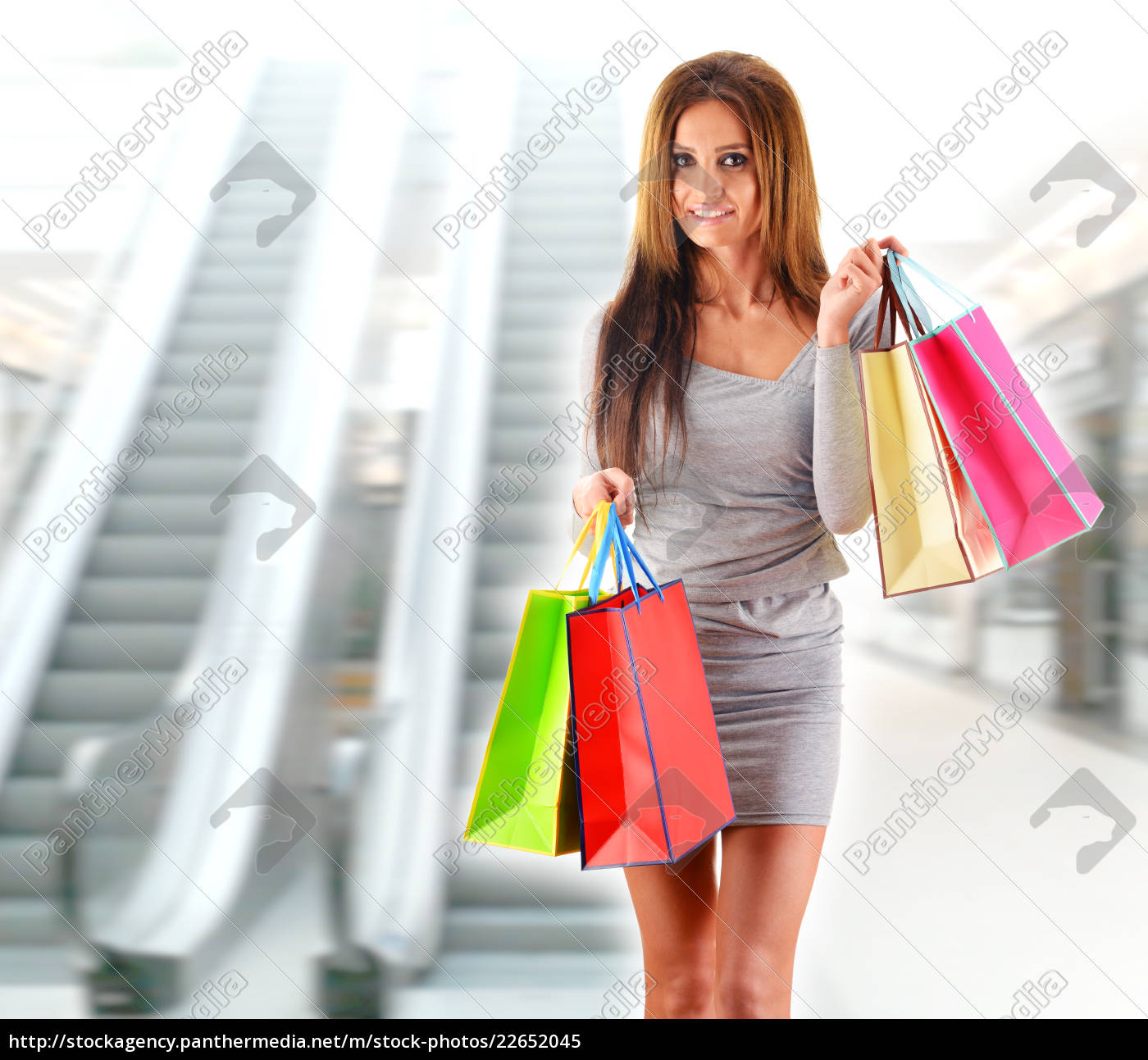 young, woman, with, bags, in, shopping - 22652045