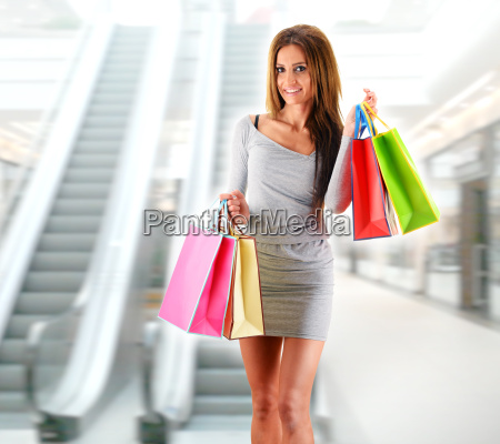 young, woman, with, bags, in, shopping - 22652047