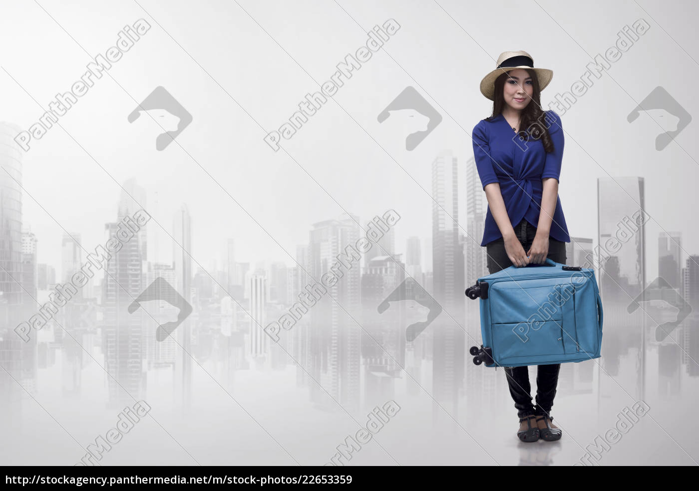 pretty, asian, traveler, woman, carrying, blue - 22653359