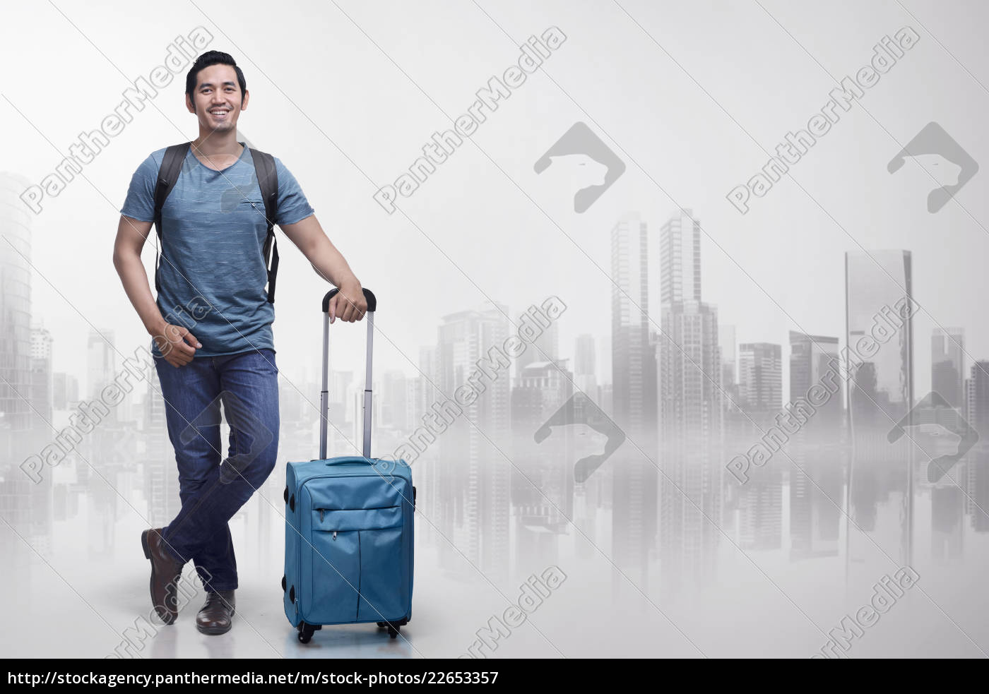 young, asian, tourist, man, with, suitcases - 22653357