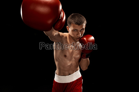 male boxer boxing with dramatic edgy