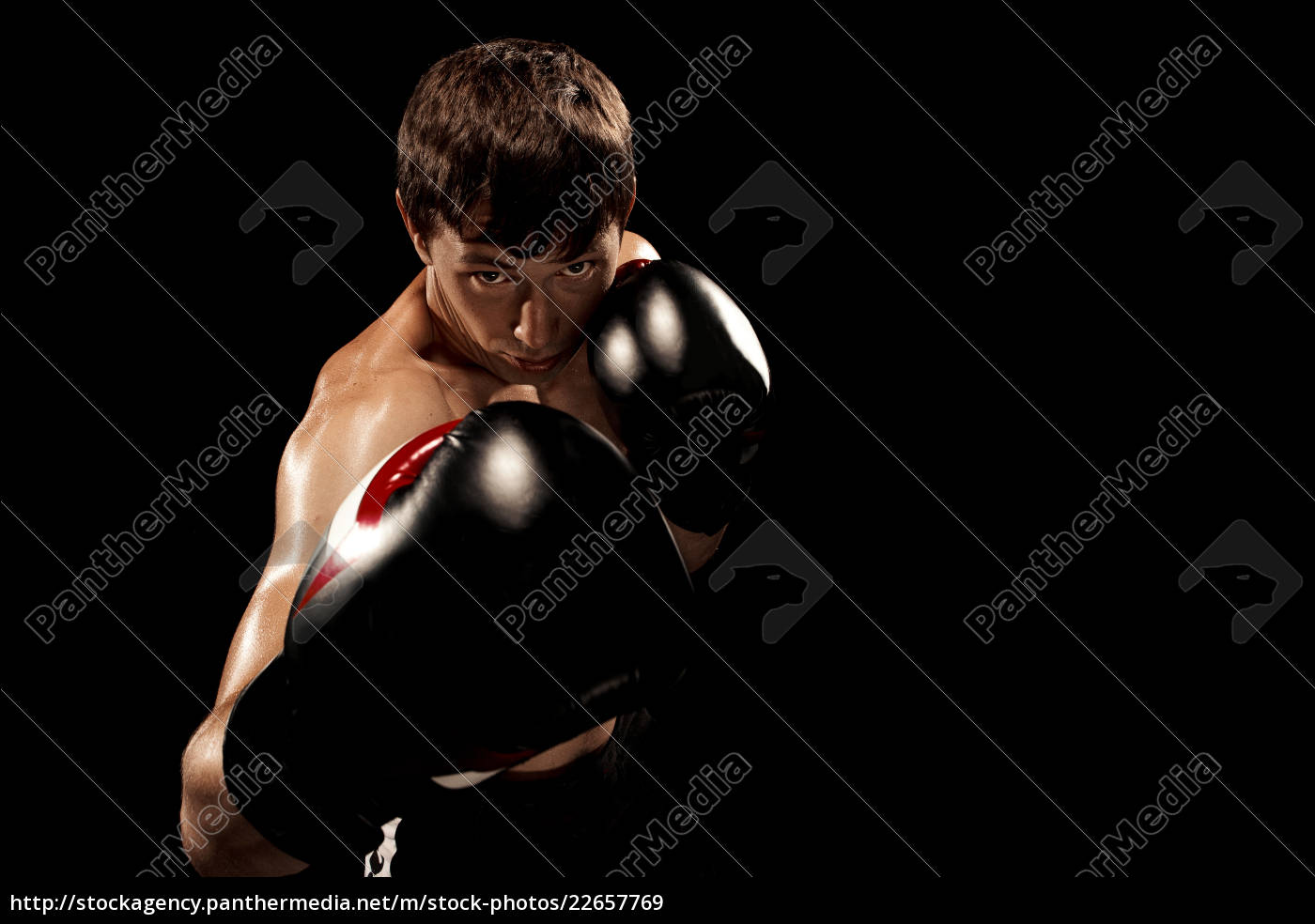 male, boxer, boxing, in, punching, bag - 22657769