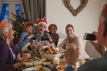 silly family christmas dinner photo