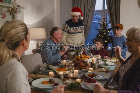 three, generation, family, christmas, dinner - 22658515