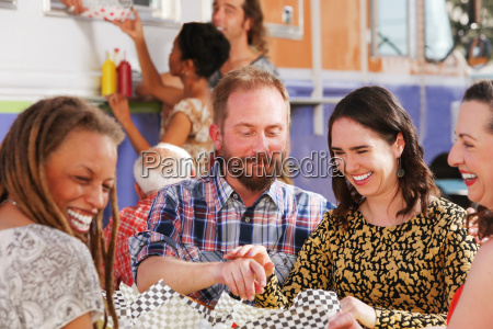 playful, couple, share, a, lunch - 22661761