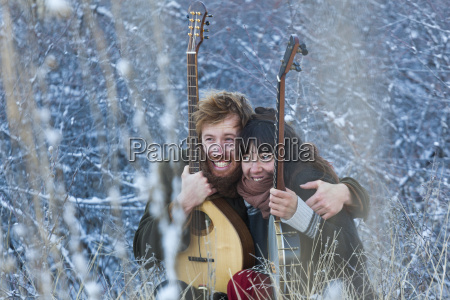 musicians hugging and smiling