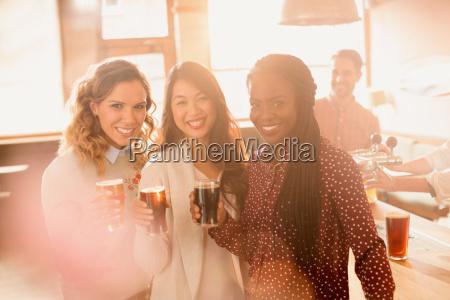 portrait smiling women friends drinking beer