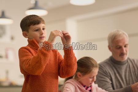 curious boy holding gadget