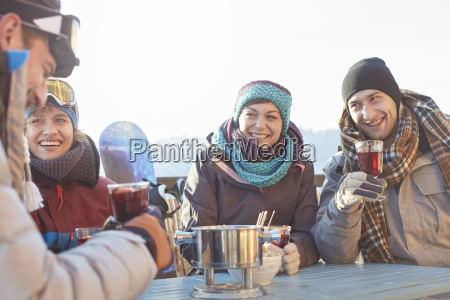 snowboarder friends drinking cocktails on sunny