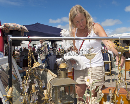 woman browsing on stall at outdoor