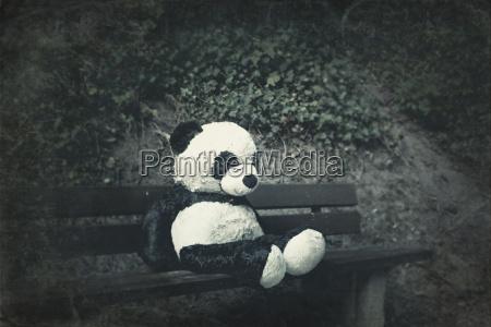 panda soft toy on a bench