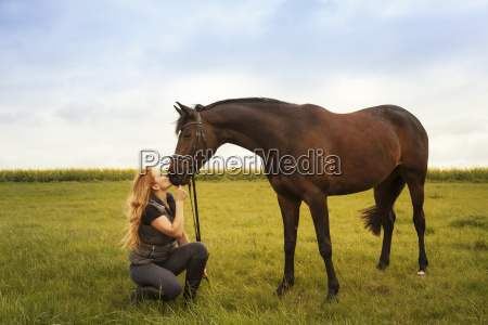 young woman with her horse on