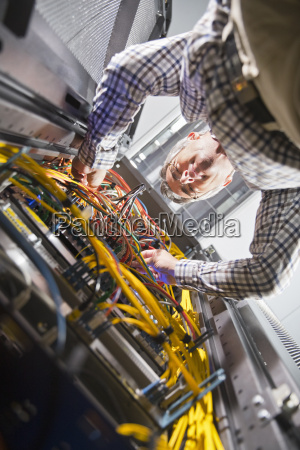 technician in secure data centre inspecting