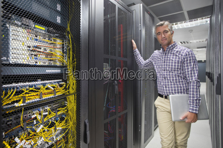 portrait of technician with laptop working