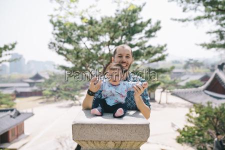 south korea seoul father and baby