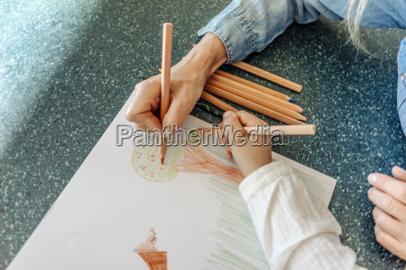 woman and girl drawing together