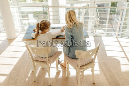 mature woman and girl at home