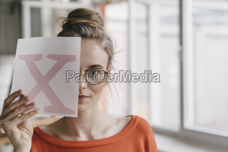 portrait of young woman holding letter