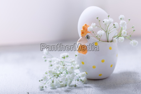 egg with flowers on a white