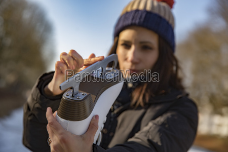 woman examining the blade of her