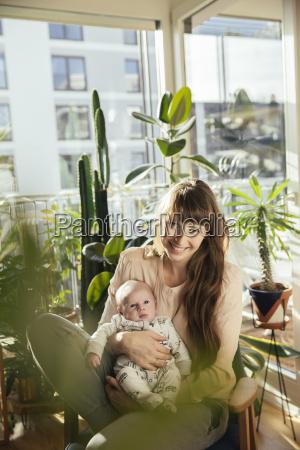 mother holding her newborn baby boy