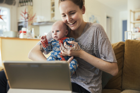 mother and newborn baby taking a