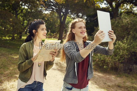 two young women with tablet and