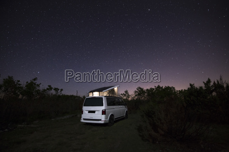camper with roof tent in the