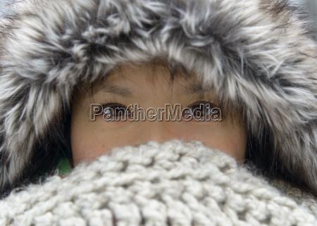 portrait of woman wearing fur cap