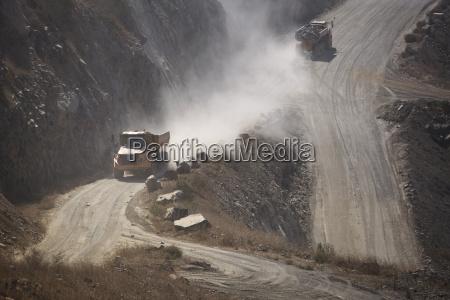 trucks driving in quarry