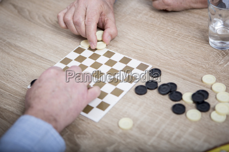 two people playing chequers