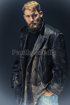 man with leather jacket in front