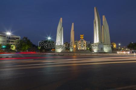 democracy monument at dusk bangkok thailand