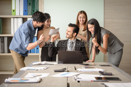 business people happy after signing agreement