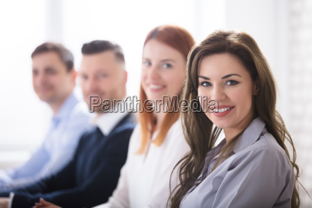 smiling woman with her colleagues