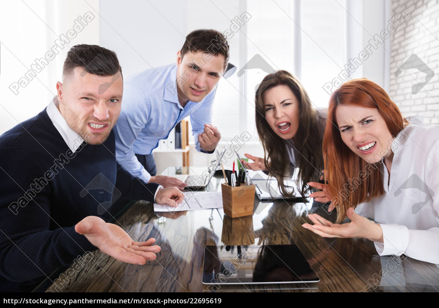 business, executives, complaining, in, office - 22695619