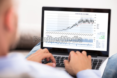 businessman, analyzing, stock, exchange, graph - 22695717