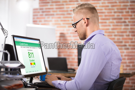 businessman, checking, credit, score, on, computer - 22695753