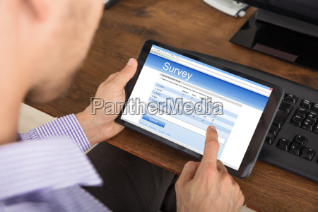 businessman, filling, survey, form, on, digital - 22695763