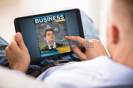 businessman, looking, at, business, magazine - 22695721