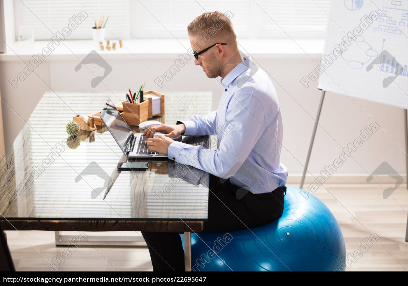 businessman, sitting, on, fitness, ball, working - 22695647