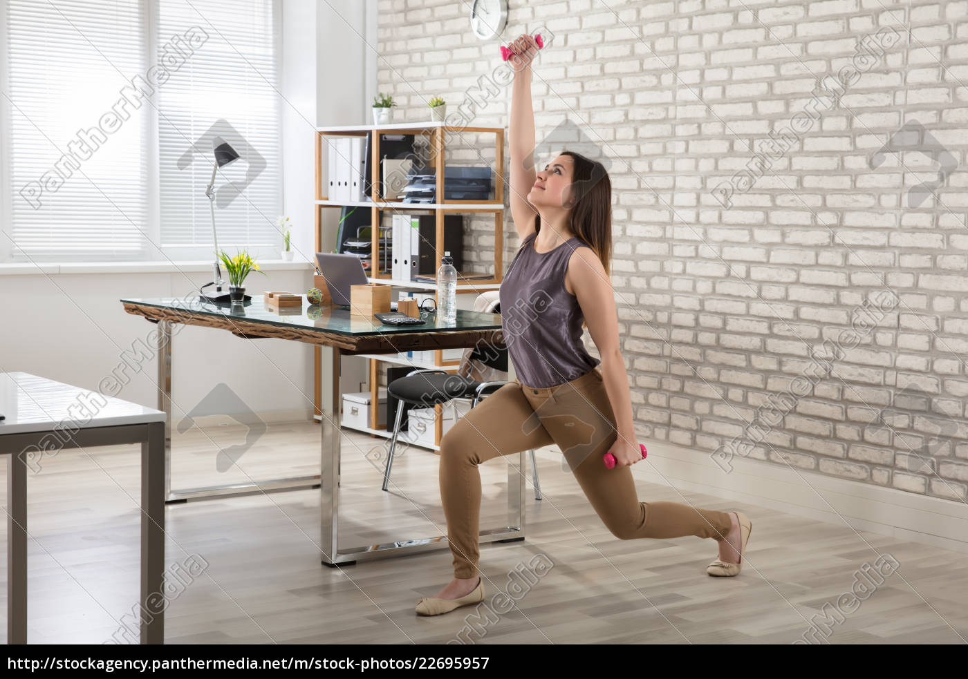 businesswoman, doing, exercise, with, dumbbells - 22695957